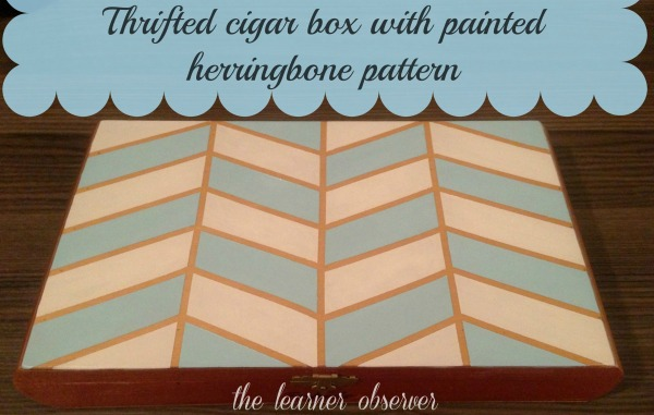 thrifted cigar box with painted herringbone pattern